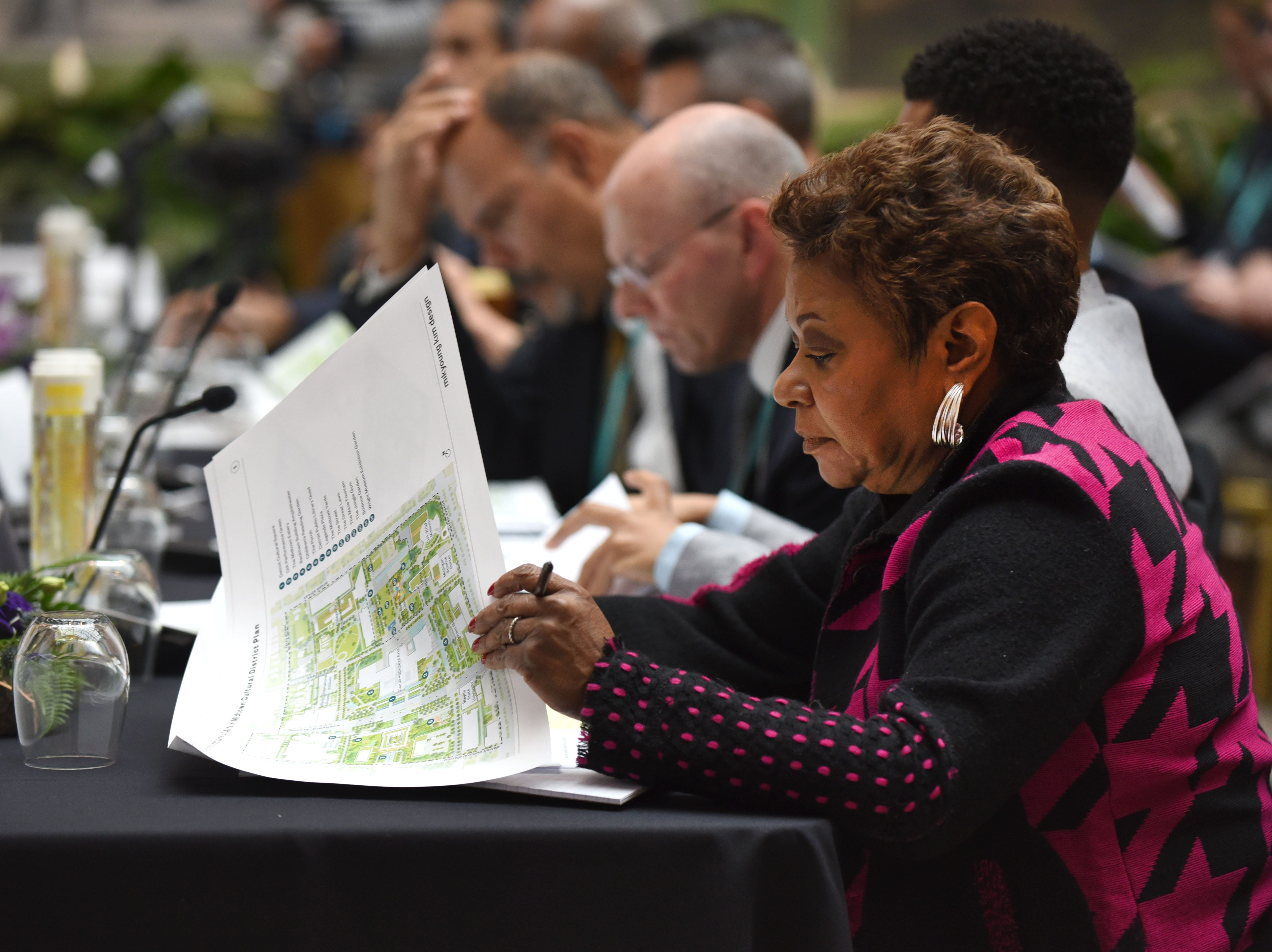Jo Anne Mondowey, executive director, Detroit Public Library, looks at renderings as part of a master design plan presented by Mikyoung Kim Design for the DIA Plaza which is part of the Midtown Cultural Campus.