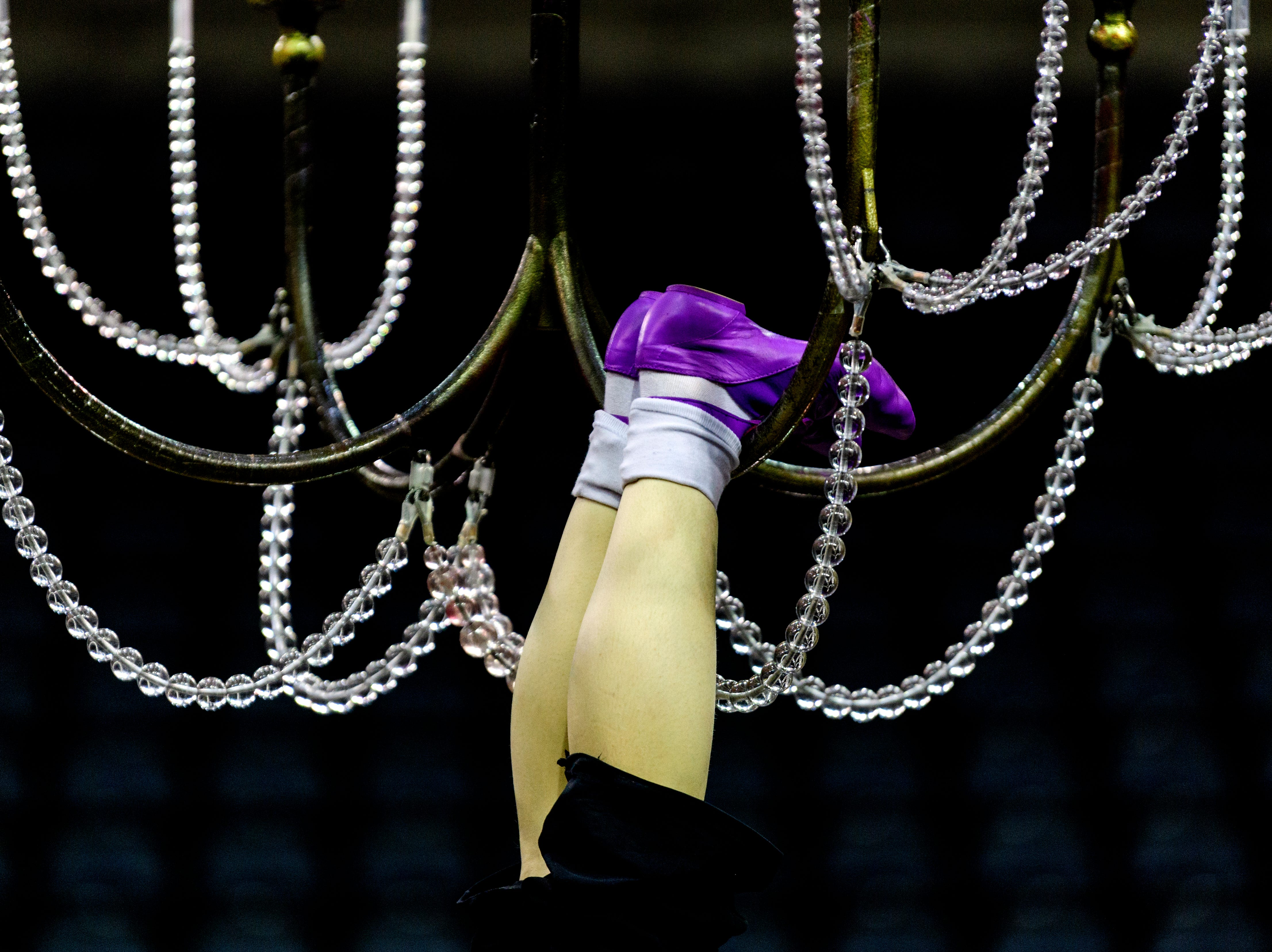 Aurélie Deroux-Dalphin hangs from a chandelier while rehearsing for the opening act of the Cirque du Soleil Coreto show at Ford Center in Evansville, Ind., Wednesday, Jan. 23, 2019.