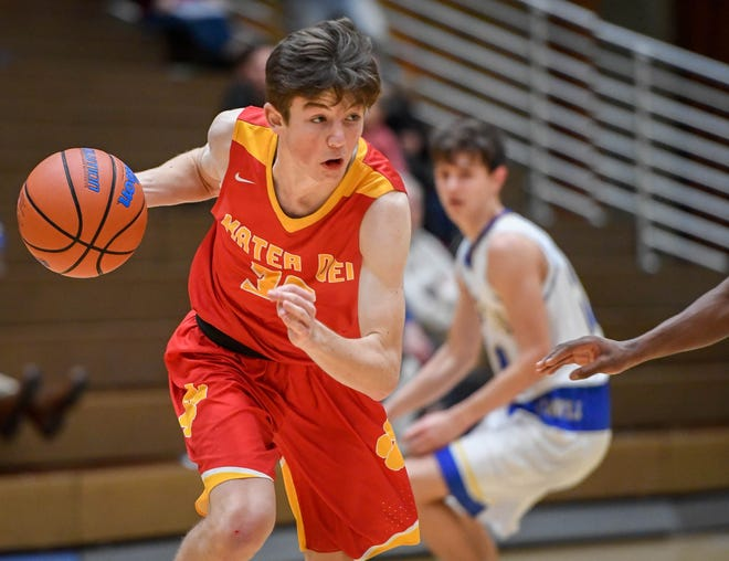 Mater Dei's Zach Schoenstein (30) drives to the the baskjet as the Mater Dei Wildcats play the Castle Knights in Paradise Tuesday, January 22, 2019.