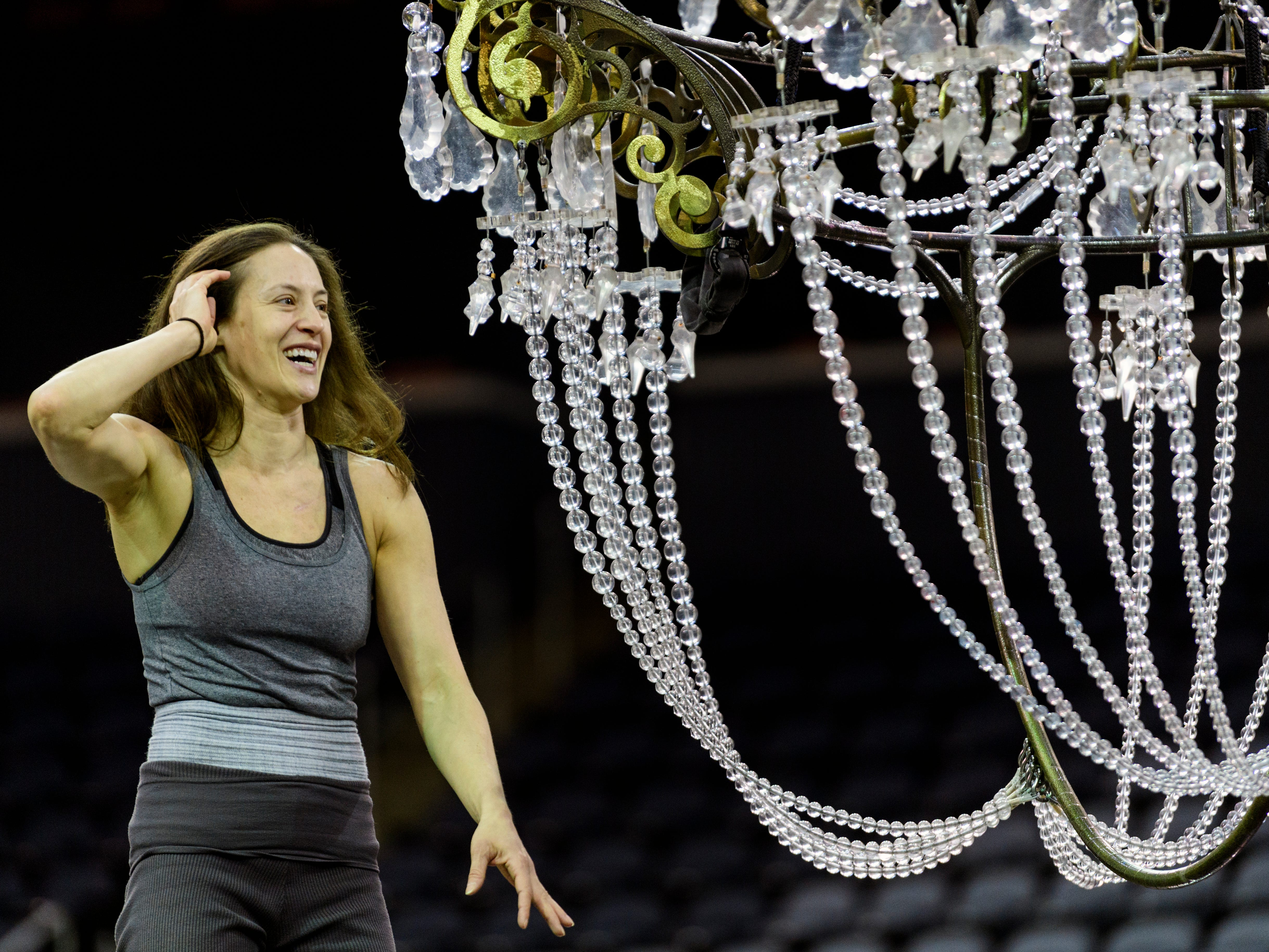 Erin Cervantes jokes around with other performers as they rehearse the opening act of the Cirque du Soleil Coreto show, which involves hanging from moving chandeliers, at Ford Center in Evansville, Ind., Wednesday, Jan. 23, 2019.