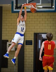 Castle's Alex Hemenway (12), dunking against Mater Dei on Jan. 22, was named All-Metro Player of the Year.
