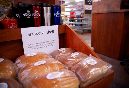 """The """"Shutdown Shelf"""" offers loaves of white or wheat bread to those affected by the partial government shutdown at Great Harvest Bread Co. at 423 Metro Avenue Wednesday morning. """"If you are a Federal Government Employee and are finding it hard to make ends meet, please take a loaf for your family!"""" the sign reads."""