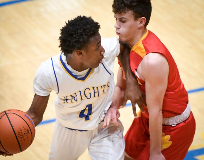 Castle's Isaiah Swope (4) drives against Mater Dei's Jonah Weinzapfel (5) as the Mater Dei Wildcats play the Castle Knights in Paradise Tuesday, January 22, 2019.