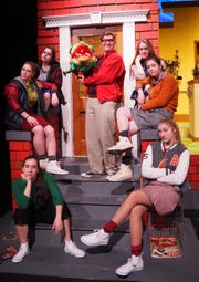 "Pictured during rehearsal for ""Little Shop of Horrors"" are, clockwise from front left, Caitlin Schmitt as Lulu, Britt Rasner as Bubbles, Shane Stadler as Chiffon, Jerome Poltrock as Seymour, Lexi Krueger as Eddie, Kennedy Kramer as Crystal and Marissa Krueger as Ronette."