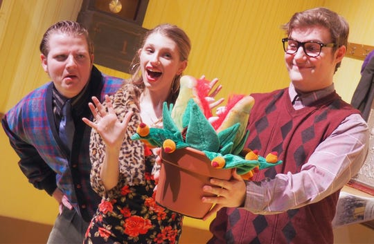 "During rehearsal for ""Little Shop of Horrors,"" from left, Parker Hambrick as Mr. Mushnik and Grace Quast as Audrey react to Audrey II, in the arms of Jerome Poltrock, playing Seymour. Fond du Lac High School is putting on the horror-comedy rock musical Jan. 31 to Feb. 3."