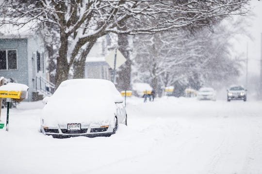 A car sits buried in snow Wednesday, January 23, 2019 on Hickory Street in Fond du Lac, Wisconsin. More than 6 inches of snow had fallen by 7am in the Fond du Lac area with heavy snow still falling. Doug Raflik/USA TODAY NETWORK-Wisconsin