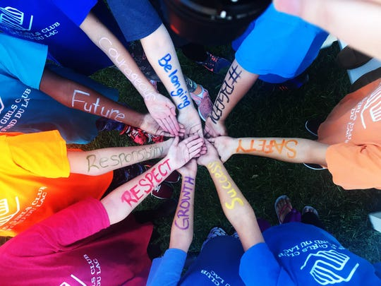 Children participating in a Boys & Girls Club summer program in Wisconsin took time to write their values on their arms. A Boys & Girls Club is coming to Henderson by late summer of 2019.