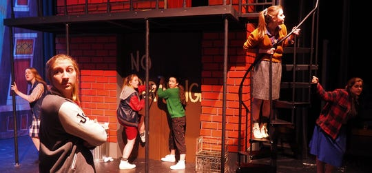 "Pictured from left, watching for police during rehearsals for ""Little Shop of Horrors"" are Lexi Krueger as Eddie, Marissa Krueger as Ronette, Britt Rasner as Bubbles, Caitlin Schmitt as Lulu, Kennedy Kramer as Crystal and Shane Stadler as Chiffon."