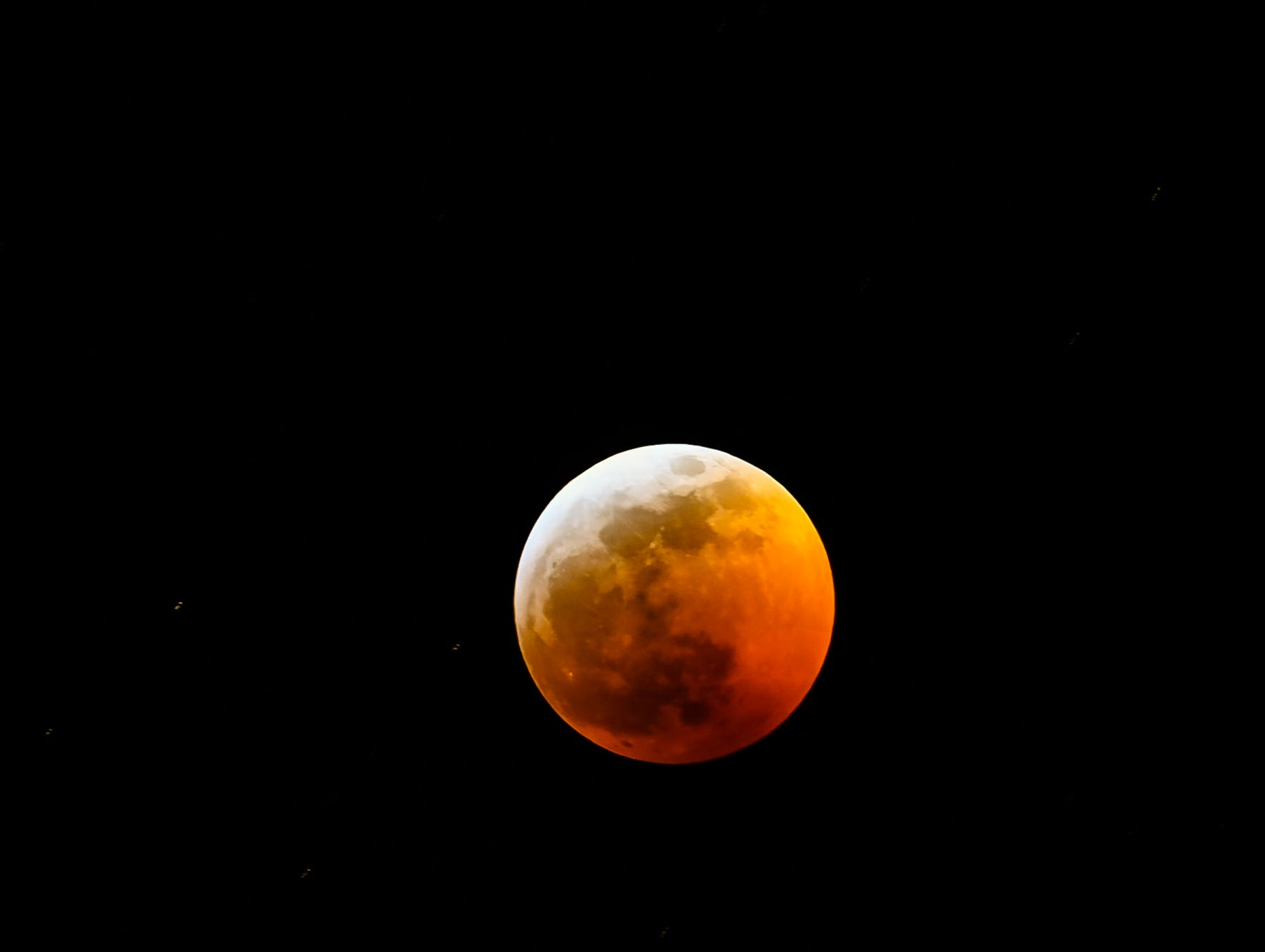 The lunar eclipse is seen from Windsor, Colo, on Sunday, Jan. 20, 2018.