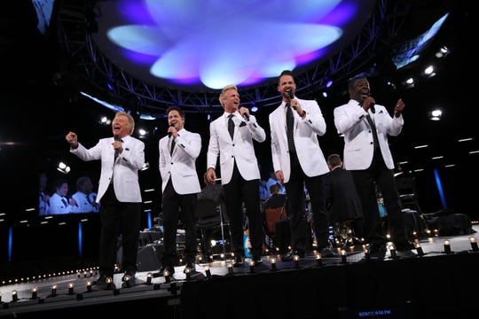 Bill Gaither (far left) and the Gaither Vocal Band