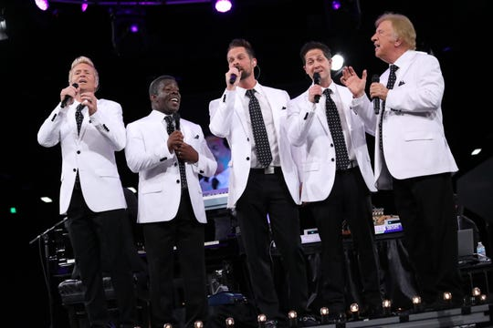 Bill Gaither (far right) and the Gaither Vocal Band