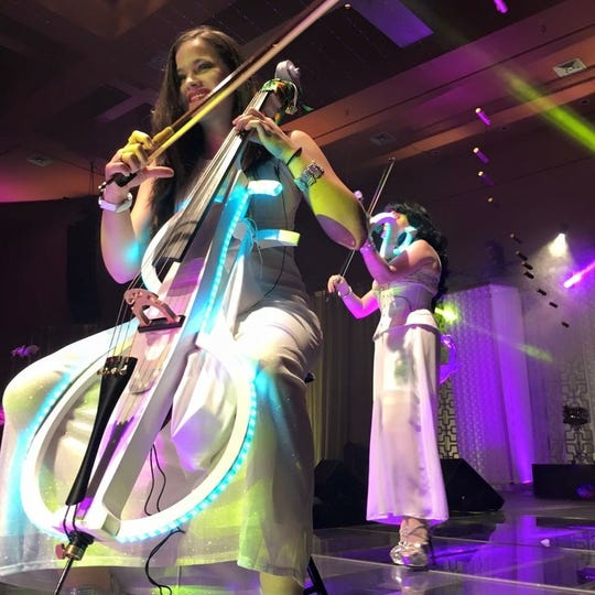 Orlando's Violectric plays rock covers using classical instruments illuminated by glowing LED lights.