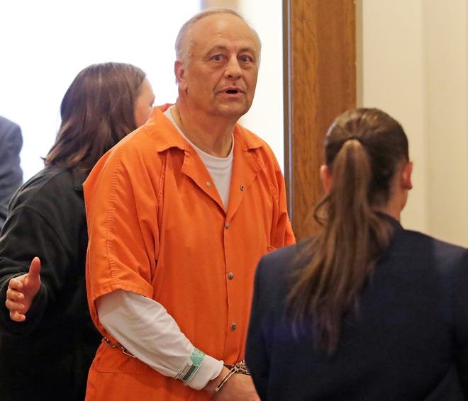 De Pere businessman Ron Van Den Heuvel leaves U.S. District Court in Green Bay after he was sentenced Jan. 23, 2019 to 7.5  years in prison for defrauding investors in his recycling business, GreenBox, of $9.4 million.