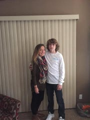 A family photo shows Tyler Butler standing with his sister, Kaitlyn Butler.