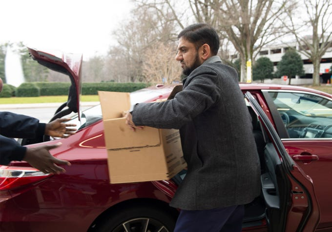 Javaid Qazi, from the Islamic Society of Greenville, delivers meals for TSA employees at GreenvilleÐSpartanburg International Airport Wednesday, Jan. 23, 2019.