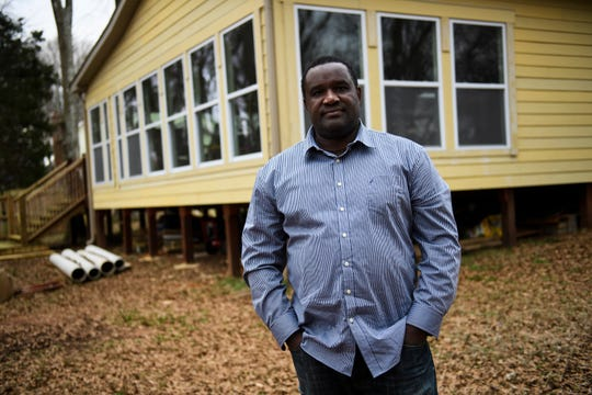 Melchior Julien stands in front of his new sunroom at his Simpsonville home on Tuesday, Jan. 22, 2019. Julien has been fighting his local HOA over its construction and believes he has been singled out over other residents who have similar structures on their property.