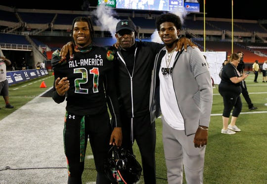 Team Ballaholics head coach Deion Sanders  poses with his son defensive back Shilo Sanders (21) at Camping World Stadium in Orlando, Fla.