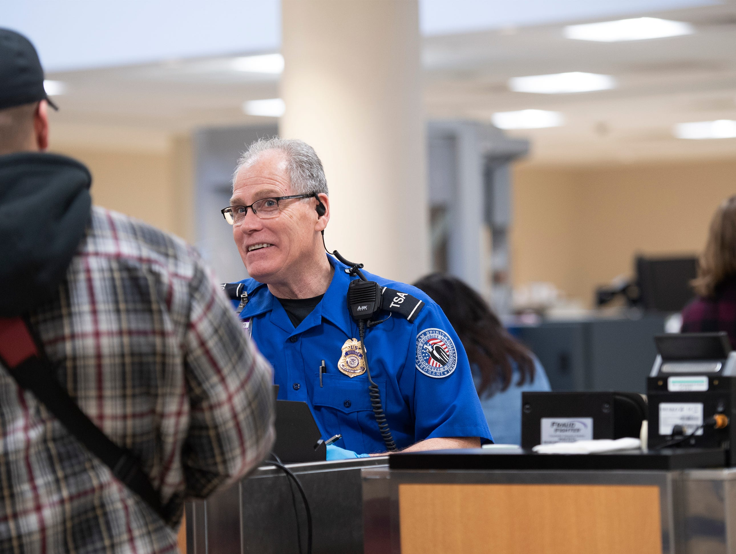 Transportation Security Administration employees screen passengers and their belongings at GreenvilleÐSpartanburg International Airport Wednesday, Jan. 23, 2019.