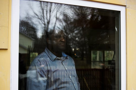 Melchior Julien looks out of the window of the sunroom he built at his Simpsonville home on Tuesday, Jan. 22, 2019. Julien says the sunroom addition was approved by his HOA but he continues to fight legal battles with them over its construction and a temporary shed he had to hold building materials.