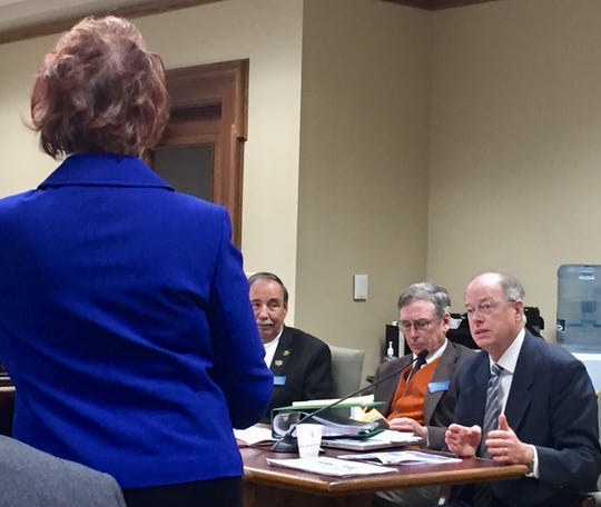 Sen. Fred Thomas, R-Stevensville, right, asks questions Wednesday of Great Falls  College CEO Susan Wolff during a hearing in Helena.