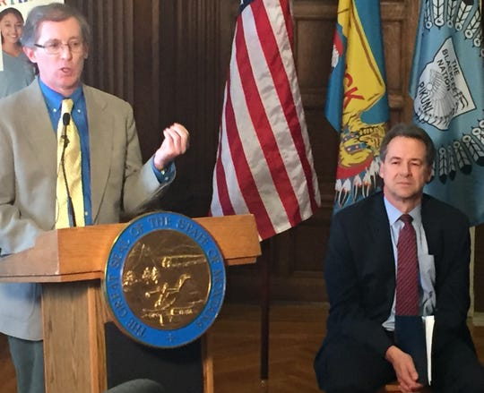 Research scientist Jay Otto, left, taks Wednesday about the MontanaParenting website as Gov. Steve Bullock looks on.