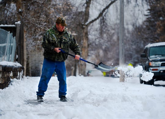 David Gill shovels his sidewalk on Wednesday afternoon as the second snow storm of the week dropped another 1 to 2 inches of snow in Great Falls.