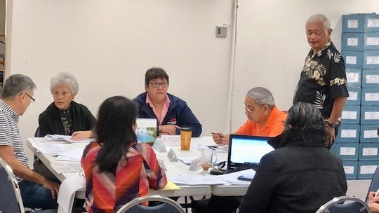 Members of the Guam Election Commission resume their meeting on Jan. 23, 2019, to continue the tabulation of thousands of write-in votes during the 2018 primary and general elections. The commission will also be purging more than 7,000 individuals from the voters' list for failing to vote in the 2016 and 2018 Guam elections.