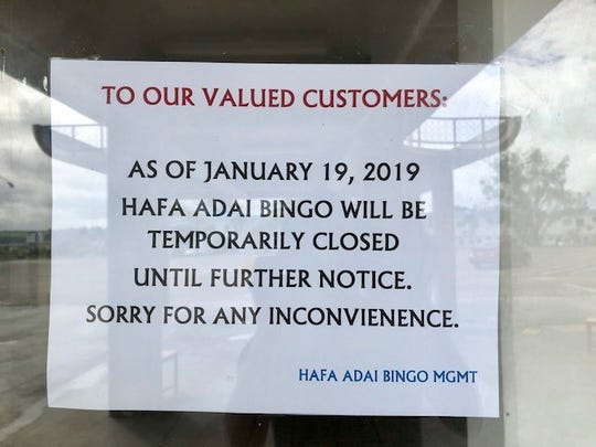 A sign about temporary closure is posted by the entrance to Hafa Adai Bingo in Tamuning on Jan. 19, 2018, a day after Pacific Daily News started raising questions about Hafa Adai Bingo's continued operations without a current permit from the Department of Revenue and Taxation beyond Dec. 31, 2018.