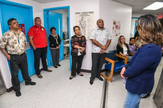Gov. Lou Leon Guerrero and Lt. Gov. Josh Tenorio, center, listen to Joann Rivera, right, Guam Memorial Hospital-Department of Corrections clinic administrator, as she explains the operation of the infirmary during their tour of the prison facility in Mangilao on Thursday,  Jan. 17, 2019.