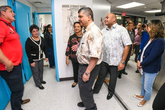Dr. Larry Lizama, front, introduces other Department of Corrections medical staff members to Gov. Lou Leon Guerrero and Lt. Gov. Josh Tenorio, as the leaders visit the infirmary during their tour of the prison facility in Mangilao on Thursday,  Jan. 17, 2019.