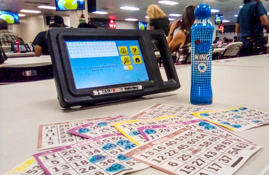 Bingo cards and a bingo machine at a bingo hall on Nov. 18, 2018.
