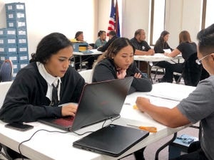 Guam Election Commission employees, on Jan. 23, 2019, resume tabulation of thousands of write-in votes during the 2018 primary and general elections.
