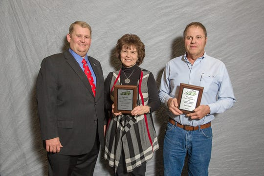(Left to right) Kentucky Soybeans Board Chairman Ryan Bivens presented Sharon  and Dennis Denney of Wayne County first place in the State Quality Award in the Kentucky Soybeans Contest at the 2018 Crop Production Awards Banquet held at the Sloan Convention Center in Bowling, Green Kentucky on January 17, 2019.