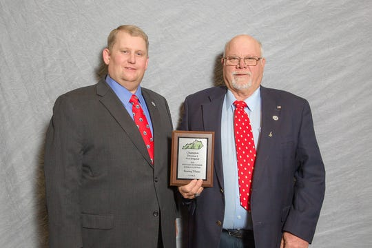 (Left to right) Kentucky Soybeans Board Chairman Ryan Bivens presented Running T Farms (Tim Thomas) of Union County the District 2 Non-Irrigated Champion in the Kentucky Soybeans Contest at the 2018 Crop Production Awards Banquet held at the Sloan Convention Center in Bowling, Green Kentucky on January 17, 2019.