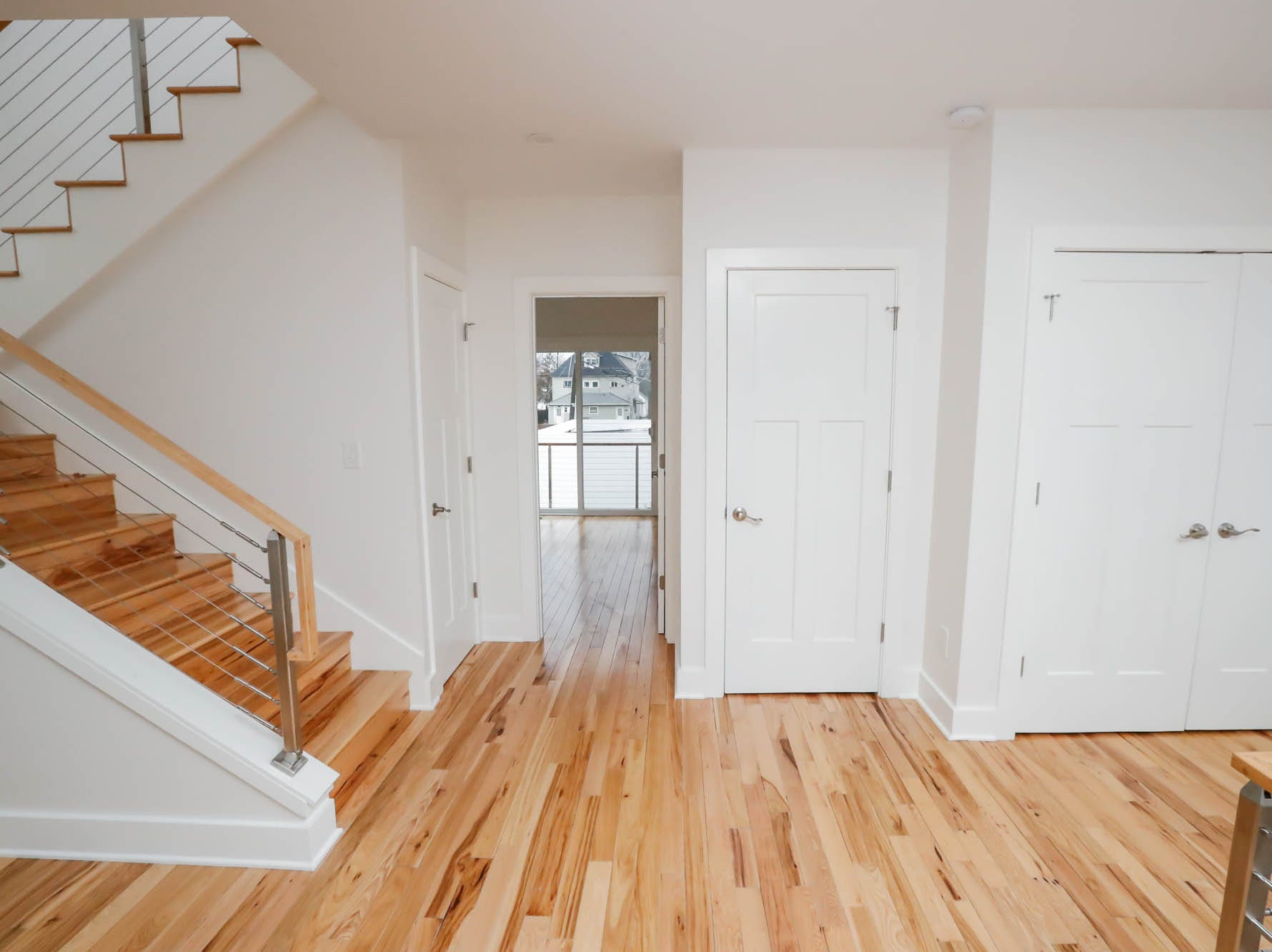 A second floor landing features a space for a home office on the left and a laundry room on the right, inside a newly built modern architectural home up for sale at 1134 Woodlawn Ave., Indianapolis, Ind., 46203, in the heart of the historic Fountain Square neighborhood on Wednesday, January, 23, 2019. The three-story home, which features 2,030-square-feet and an open space concept tile and hardwood floors are priced at $479,900.