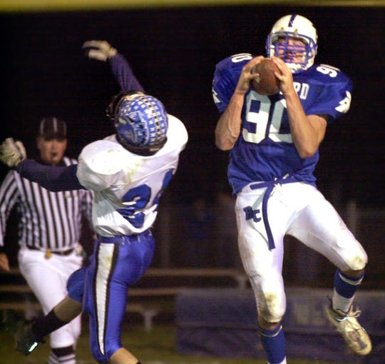 Ryan Baker (90) played tight end and defensive line for Bishop Chatard.
