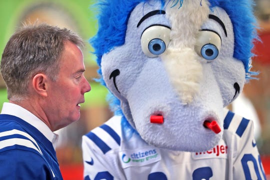 Mayor Joe Hogsett and Colts mascot Blue have a deep conversation after they signed a 1-0 banner for the Colts at City Market, Thursday, Jan. 10, 2019.  The banner will be displayed for the team to see at the airport as they head off to their Kansas City playoff game.