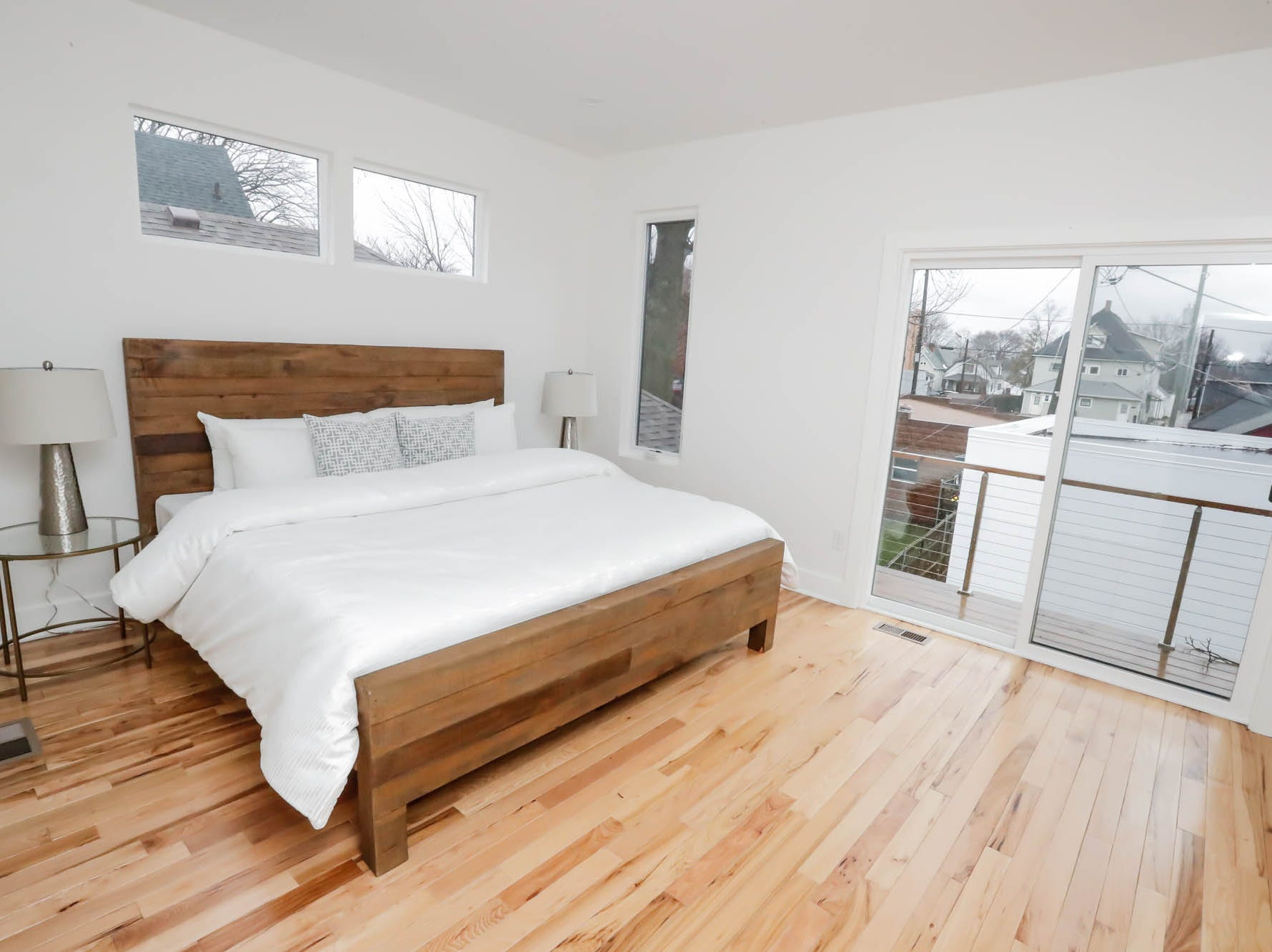 A second-floor master bedroom with attached bath features a walk out back porch at a newly built modern architectural home up for sale at 1134 Woodlawn Ave., Indianapolis, Ind., 46203, in the heart of the historic Fountain Square neighborhood on Wednesday, January 23, 2019. The three-story home, which features 2,030-square-feet and an open space concept tile and hardwood floors are priced at $479,900.