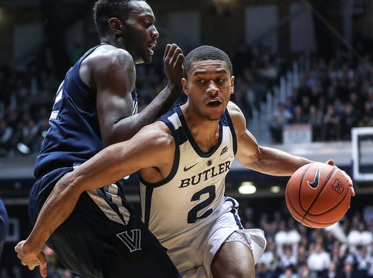 Butler Bulldogs guard Aaron Thompson (2) drives the ball around Villanova Wildcats forward Dhamir Cosby-Roundtree (21) during the first half of the game at Hinkle Fieldhouse in Indianapolis, Tuesday, Jan. 22, 2019.