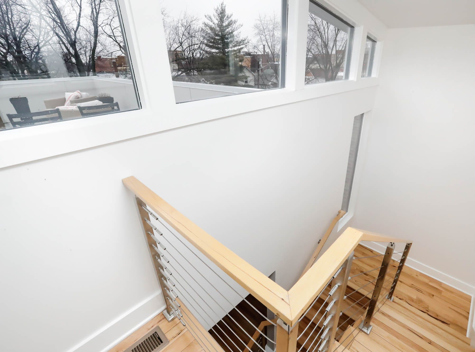 A staircase leads to a third-floor exterior patio at a newly built modern architectural home up for sale at 1134 Woodlawn Ave., Indianapolis, Ind., 46203, in the heart of the historic Fountain Square neighborhood on Wednesday, January 23, 2019. The three-story home, which features 2,030-square-feet and an open space concept tile and hardwood floors are priced at $479,900.