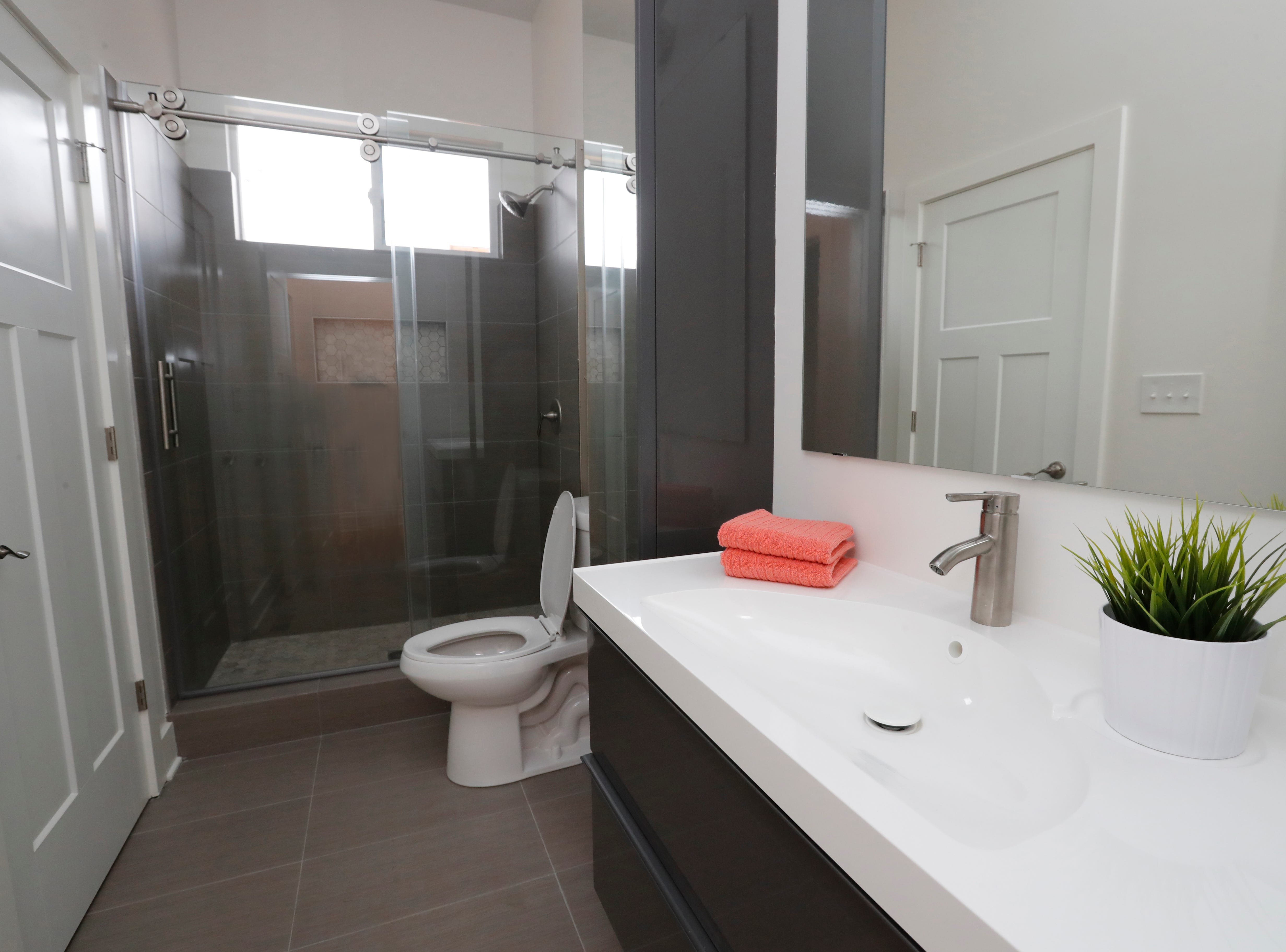 A first-floor bedroom with attached bath provides future homeowners the option of a master suite on the first floor inside a newly built modern architectural home up for sale at 1134 Woodlawn Ave., Indianapolis, Ind., 46203, in the heart of the historic Fountain Square neighborhood on Wednesday, January 23, 2019. The three-story home, which features 2,030-square-feet and an open space concept tile and hardwood floors are priced at $479,900.