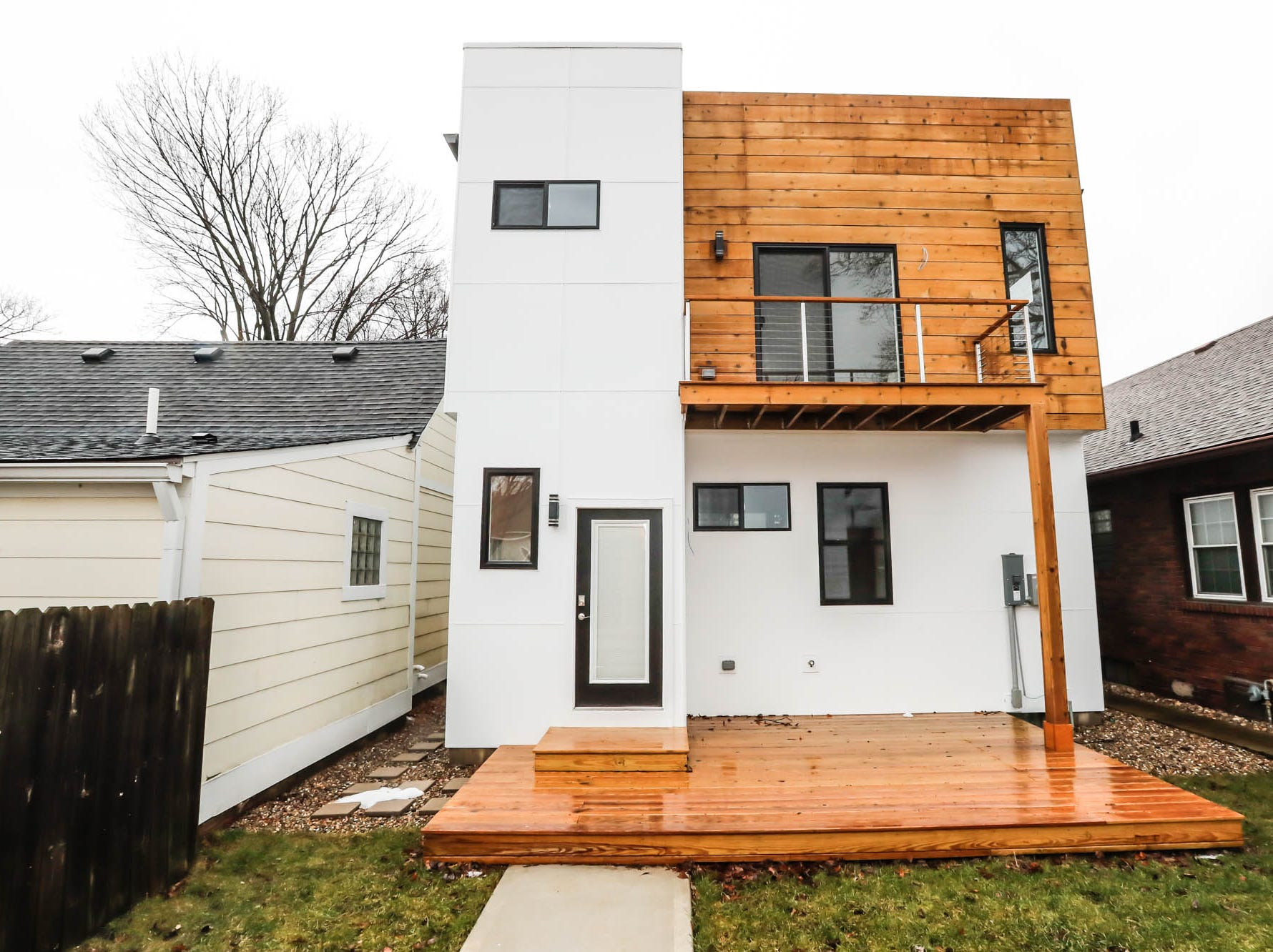 A newly built modern architectural home, rear showed here, is up for sale at 1134 Woodlawn Ave., Indianapolis, Ind., 46203, in the heart of the historic Fountain Square neighborhood on Wednesday, January 23, 2019. The three-story home, which features 2,030-square-feet and an open space concept tile and hardwood floors are priced at $479,900.