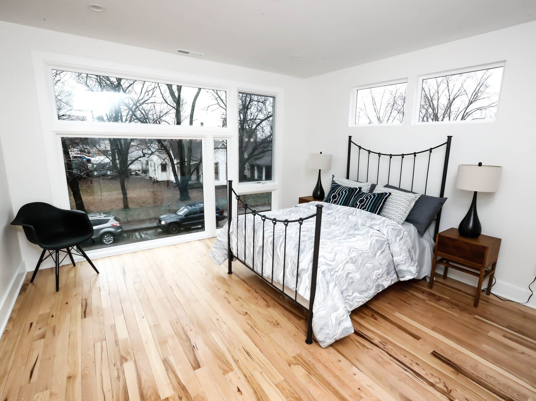 A second-floor bedroom features large windows inside a newly built modern architectural home up for sale at 1134 Woodlawn Ave., Indianapolis, Ind., 46203, in the heart of the historic Fountain Square neighborhood on Wednesday, January 23, 2019. The three-story home, which features 2,030-square-feet and an open space concept tile and hardwood floors are priced at $479,900.