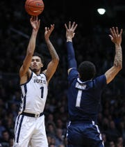 Villanova Wildcats guard Jahvon Quinerly (1) tries to block a shot by Butler Bulldogs forward Jordan Tucker (1) in the first half of the game at Hinkle Fieldhouse in Indianapolis, Tuesday, Jan. 22, 2019. Butler lost, 72-80.