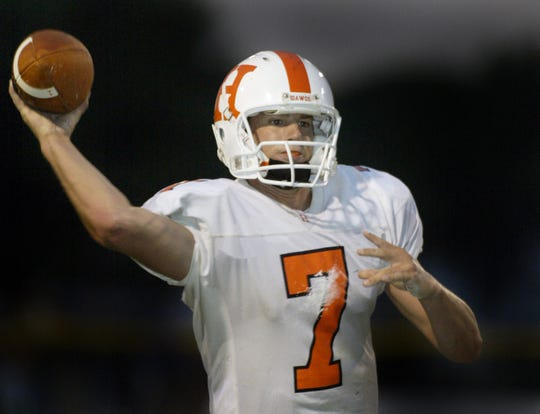Hamilton Heights QB Dustin Sherer drops back for a pass in 2004.