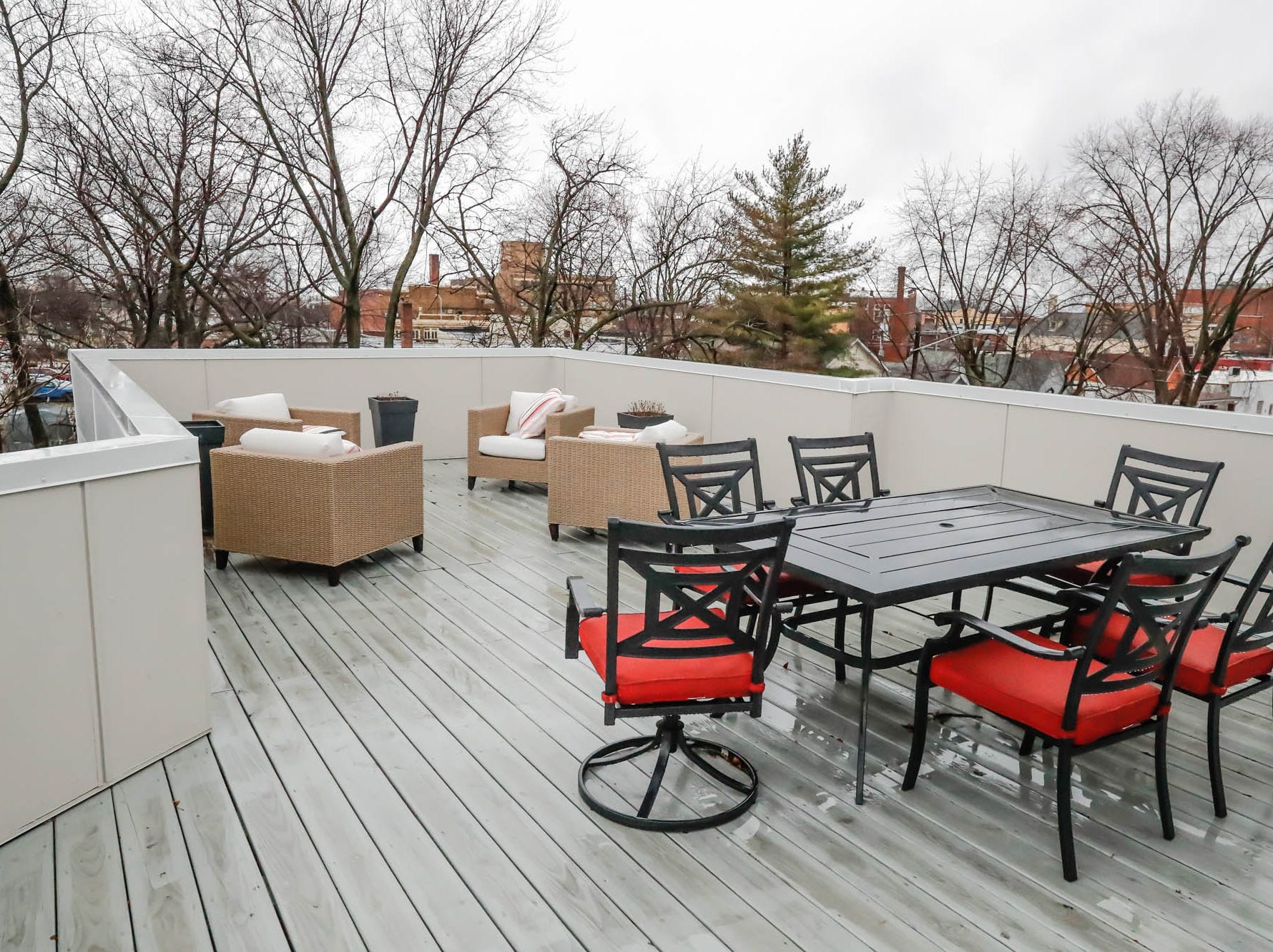 A large third-floor patio features views of downtown and historical Fountain Square at a newly built modern architectural home up for sale at 1134 Woodlawn Ave., Indianapolis, Ind., 46203, on Wednesday, January 23, 2019. The three-story home, which features 2,030-square-feet and an open space concept tile and hardwood floors are priced at $479,900.