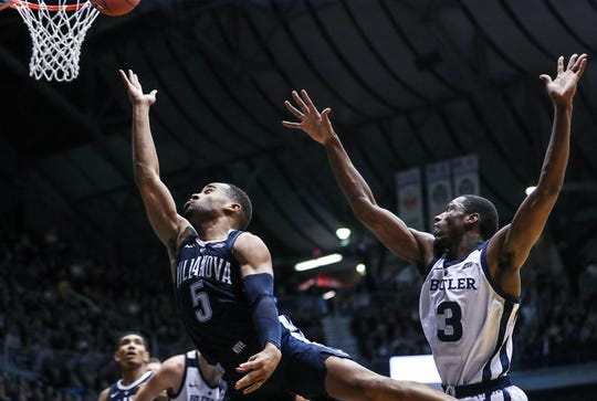 Butler Bulldogs guard Kamar Baldwin (3) is unable to stop a shot by Villanova Wildcats guard Phil Booth (5) during the second half of the game at Hinkle Fieldhouse in Indianapolis, Tuesday, Jan. 22, 2019. Butler lost, 72-80.