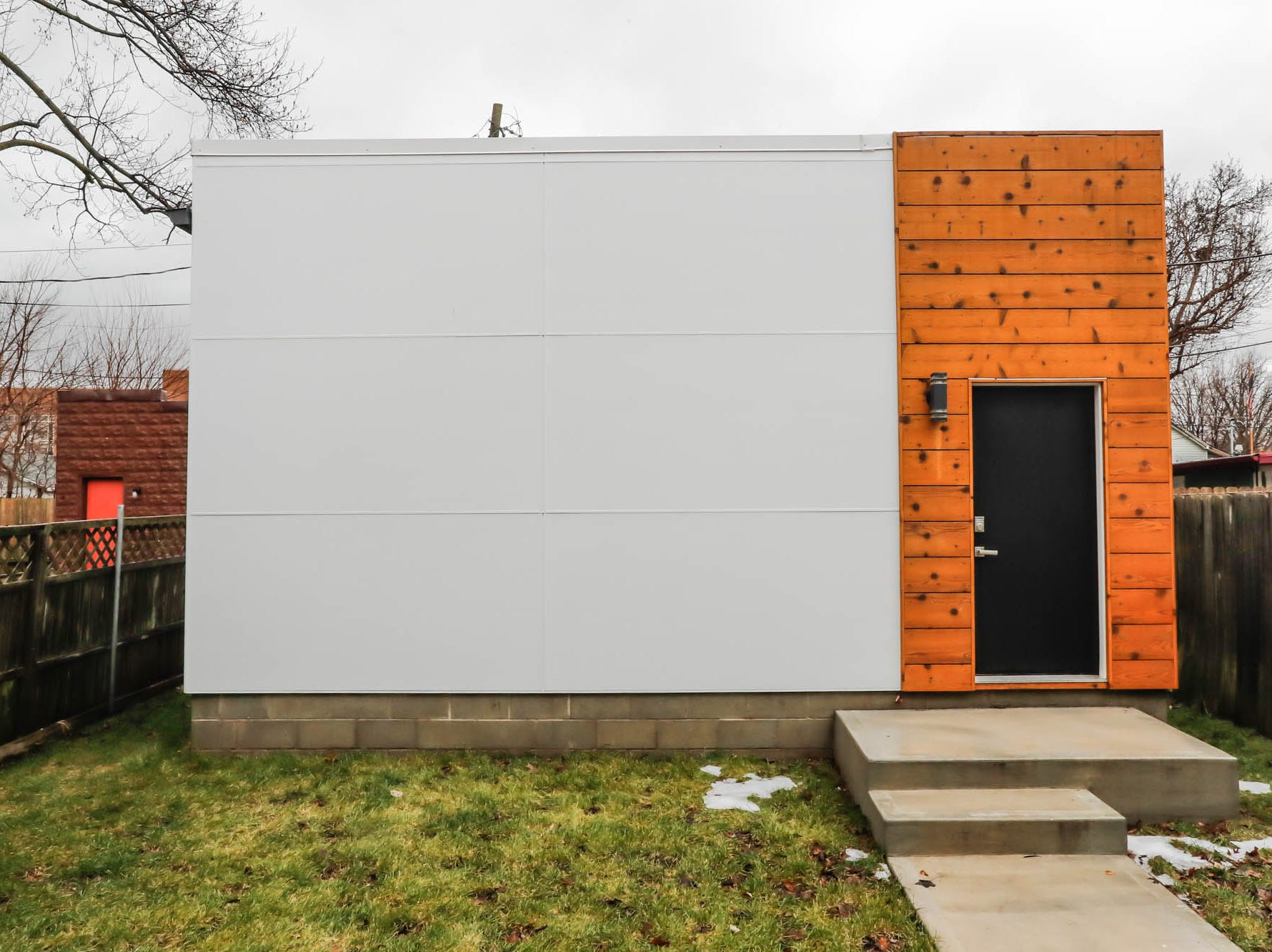 A newly built modern architectural home with unattached garage, shown here, is up for sale at 1134 Woodlawn Ave., Indianapolis, Ind., 46203, in the heart of the historic Fountain Square neighborhood on Wednesday, January 23, 2019. The three-story home, which features 2,030-square-feet and an open space concept tile and hardwood floors are priced at $479,900.
