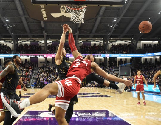 Indiana forward Justin Smith (3) and Northwestern forward Aaron Falzon (35) go for the ball during the second half of an NCAA college basketball game Tuesday, Jan. 22, 2019, in Evanston, Ill. Northwestern won 73-66.