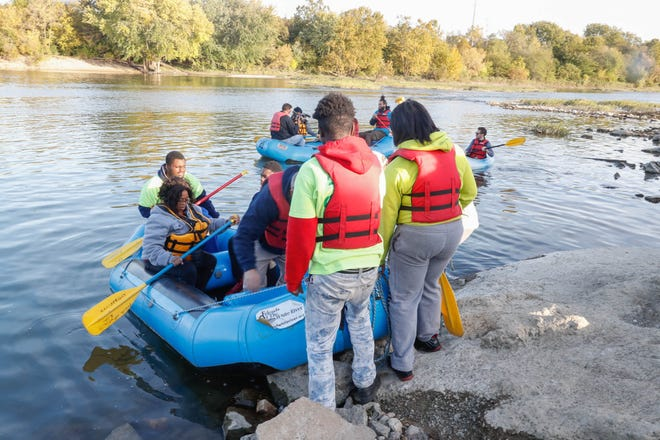 ROW, Friends of the White River and Groundworks Indy take guests for a float on the White River in Indianapolis on Wed., Oct. 24, 2018.